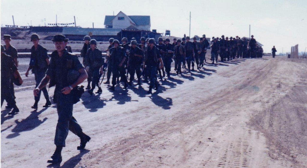Troops marching to trucks for Bob Hope show