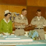 Paula Lukey, Bob Turner and Richard Epting cutting cake with bayonet